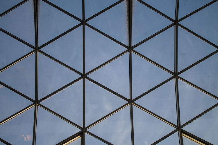 Abstract Architectural Feature Backgrounds Design Detail Directly Below Full Frame Geometric Shape Glass - Material Low Angle View Modern Pattern Pattern, Texture, Shape And Form Repetition Shape Sky Urban Urban Geometry