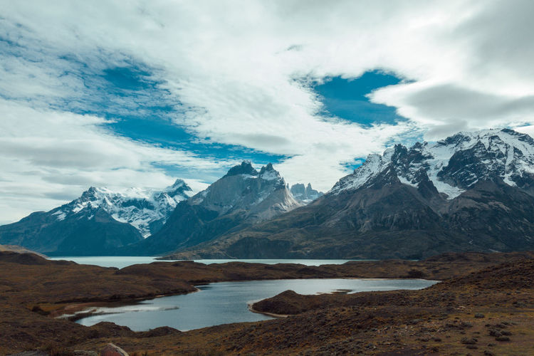 Chile National Park Beauty In Nature Cloud - Sky Cold Temperature Day Landscape Mountain Mountain Range Mountain Ranges Nature No People Outdoors Patagonia Scenics Sky Snow Snowcapped Mountain Torres Del Paine Tranquil Scene Tranquility Travel Destination Travel Destinations Water