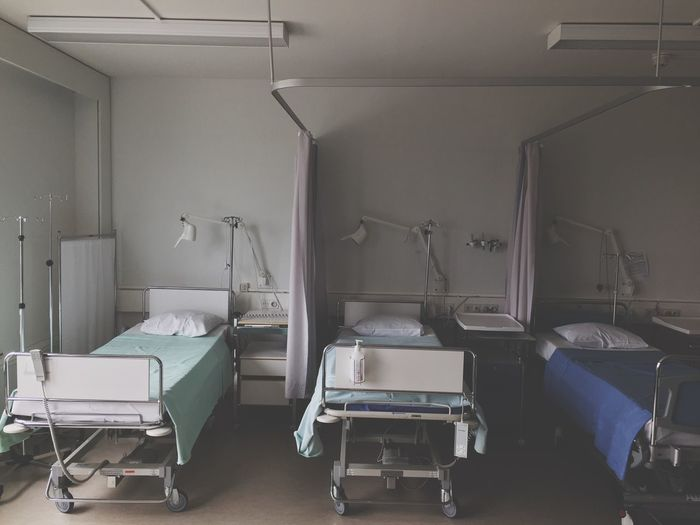 Empty chairs and tables on bed in building