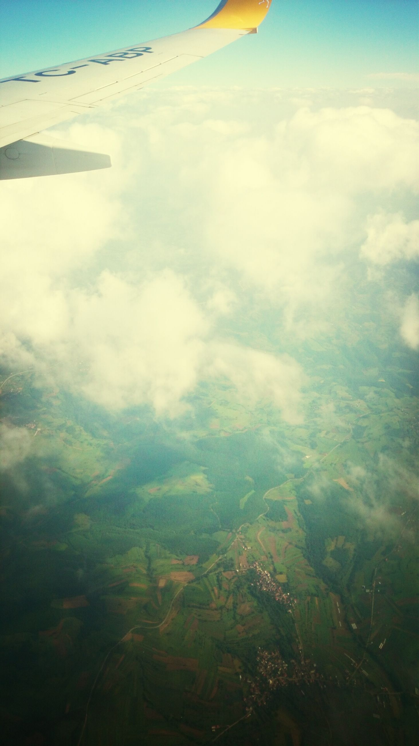 aerial view, airplane, sky, flying, landscape, air vehicle, aircraft wing, scenics, transportation, beauty in nature, cloud - sky, tranquility, part of, tranquil scene, mid-air, nature, mode of transport, cloud, cropped, travel