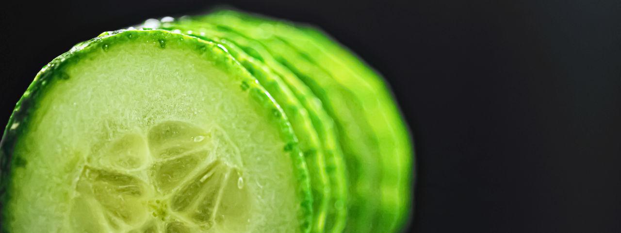 Close-up of lemon slice over black background
