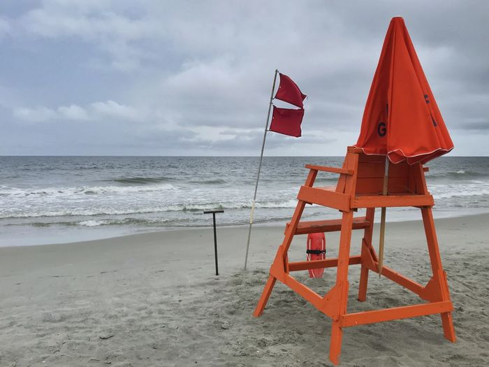 Beach closed by lifeguard on a stormy day Red Flag Two Red Flags Beach Closed Unsafe Safety Storm Ocean Myrtle Beach Rescue Can Chair STAND Lifeguard  Beach Land Water Sea Horizon Horizon Over Water Sky Sand Nature Flag Beauty In Nature Cloud - Sky Scenics - Nature Safety Lifeguard  Day Protection