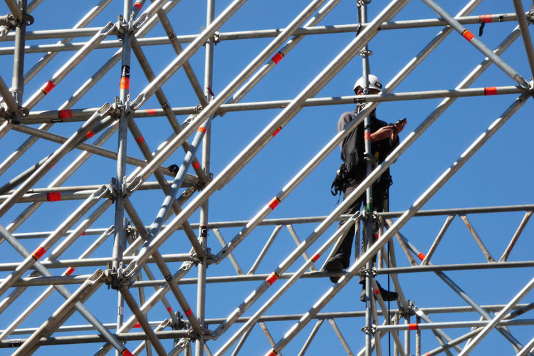 Architecture Blue Built Structure Clear Sky Construction Industry Construction Site Day Group Of People Low Angle View Men Metal Metalic Structure Nature Occupation Outdoors Pattern People Real People Sky Working