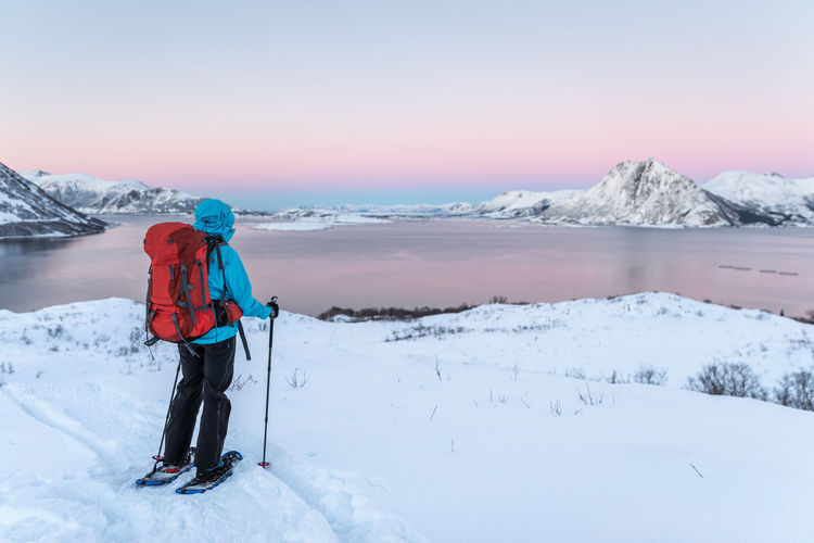 The Great Outdoors - 2017 EyeEm Awards Adults Only Adventure Beauty In Nature Cold Temperature Day Full Length Glacier Hiking Ice Landscape Mountain Nature Norway One Person Only Men Outdoors Pastel Power Rear View Scenics Snow Snowshoeing Vesterålen Warm Clothing Winter