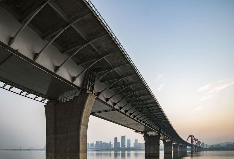 under the bridge Architecture Bridge Bridge - Man Made Structure Building Exterior Built Structure City Connection Day Engineering Low Angle View No People Outdoors River Sky Suspension Bridge Transportation Underneath Water