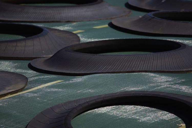 High angle view of tires on tarpaulin