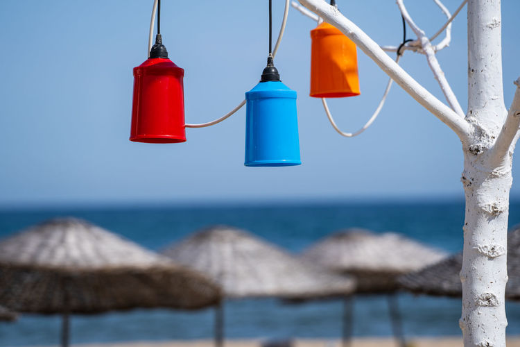 Clothes hanging on beach against clear blue sky