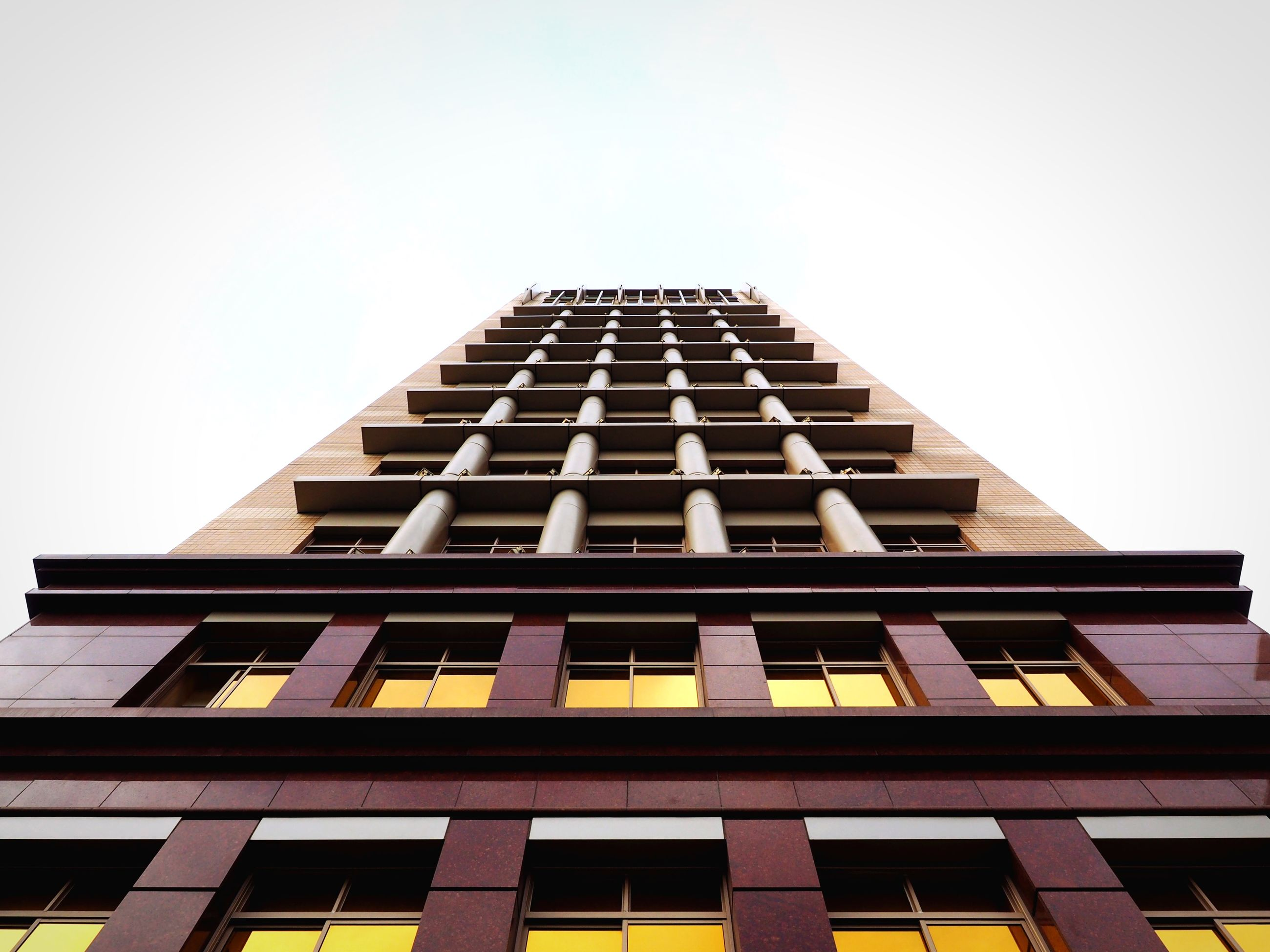 architecture, built structure, building exterior, low angle view, clear sky, window, building, copy space, city, in a row, repetition, day, no people, outdoors, residential structure, residential building, modern, tall - high, sky, office building