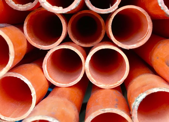 Plastic tubes or pipings are seen at a shelf in Taguig city in Metropolitan Manila Philippines. The OO Mission Plastic Tube Pipes Art Plastic Tube Plastic Pipe Philippines Taguig Orange Orange Color Orange Tube Orange Pipe Circles Circles In Circles