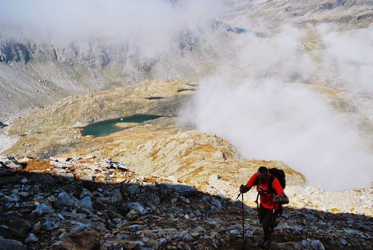 Hiker Walking Against Volcanic Crater