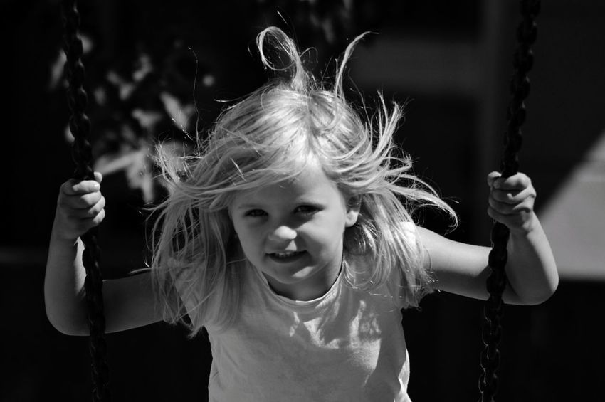 Sunlight monochrome photography Black And White Photography Black And White Happiness Swing One Person Front View Real People Leisure Activity Girls Portrait Females Lifestyles Child Hair Childhood Focus On Foreground Headshot Long Hair Hairstyle Human Arm Arms Raised The Portraitist - 2018 EyeEm Awards The Great Outdoors - 2018 EyeEm Awards