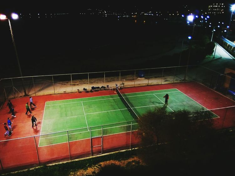 Sport Match - Sport Large Group Of People People Outdoors Sports Track Tennis Court Tennis 🎾 Tennis Practice Tennis Tennis Game Practicing Healthy Lifestyle Healthy Living Sports Sports Photography Sport In The City City Life Night Photography High Angle View Night Illuminated Trainning Women Around The World