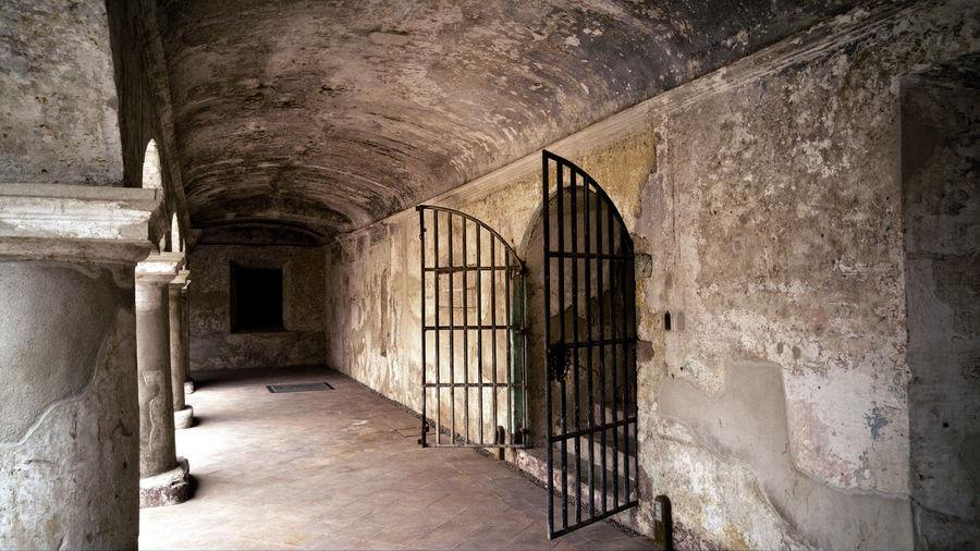 Open Gate In Corridor Of Old Prison