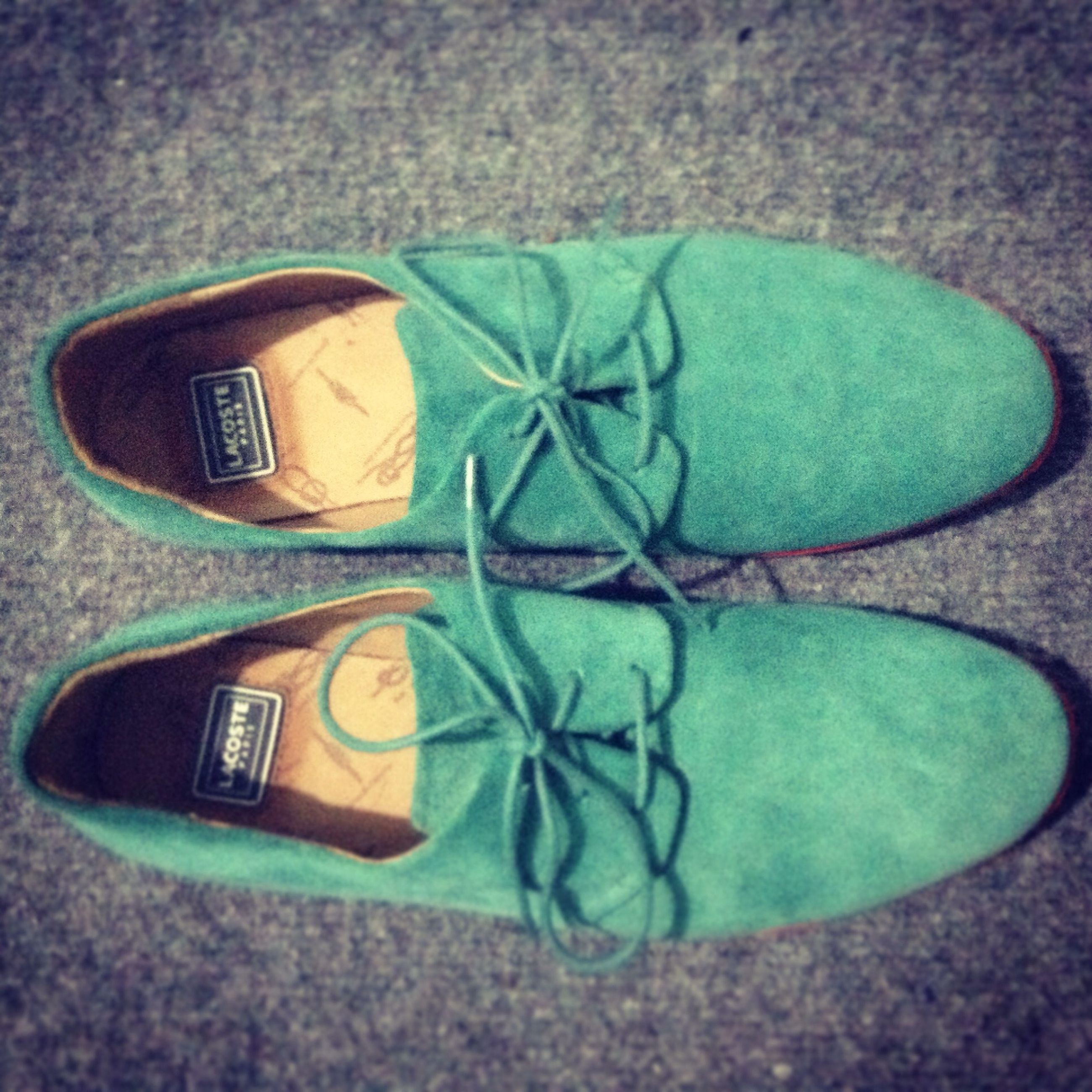 shoe, jeans, low section, pair, footwear, person, standing, green color, high angle view, blue, still life, close-up, canvas shoe, street, day, casual clothing, shoelace, outdoors