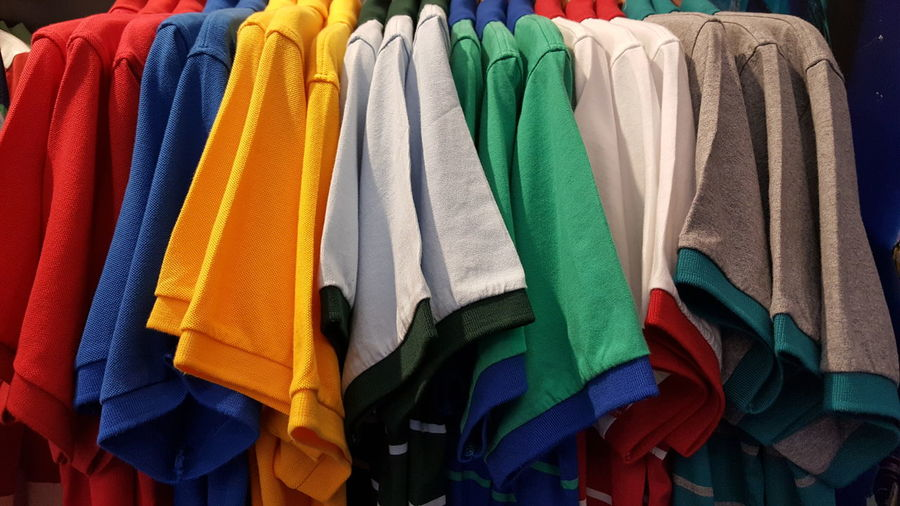 Close-Up Of Colorful Clothes Hanging On Display At Store