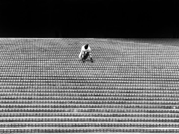 One person napping on steps