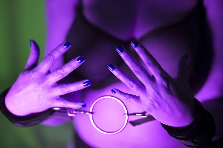 Midsection of woman with handcuffs