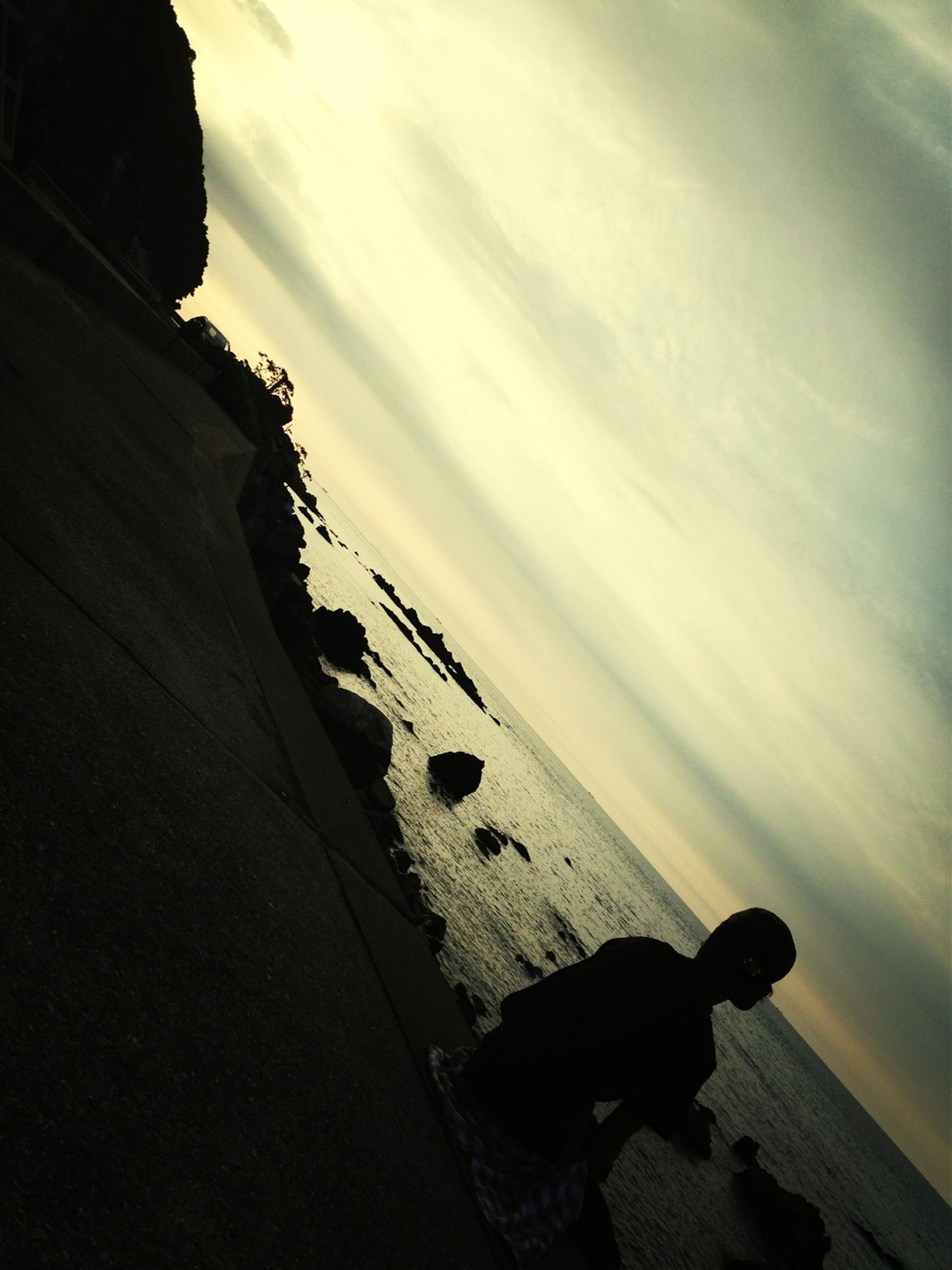 sea, sky, beach, silhouette, shore, horizon over water, lifestyles, water, men, cloud - sky, leisure activity, unrecognizable person, sand, nature, tranquility, scenics, outdoors, beauty in nature