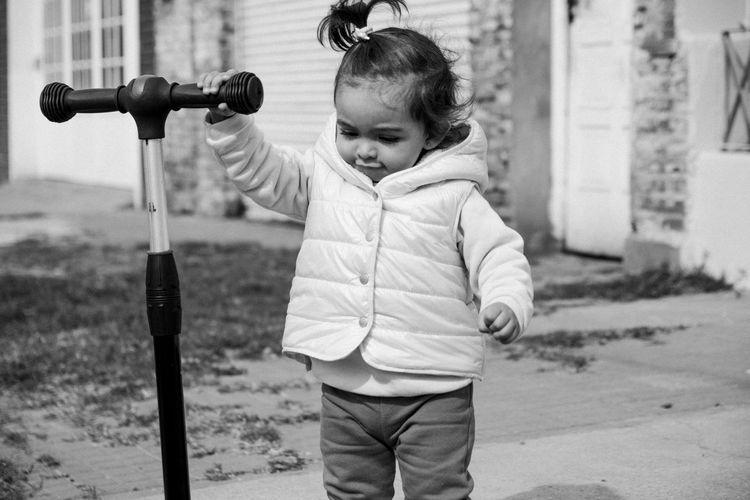 Cute boy standing outdoors