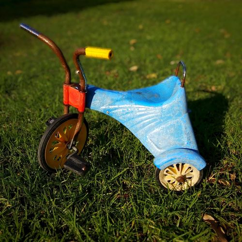 Vintage kids tricycle Vintage Tricycle Kids Bike Tricycles  Vintage Grass No People Day Blue Outdoors Close-up