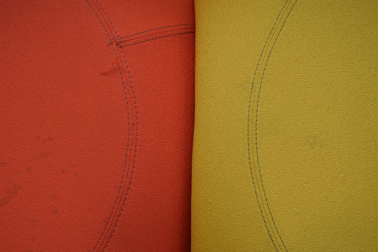 Full frame shot of red and yellow seat