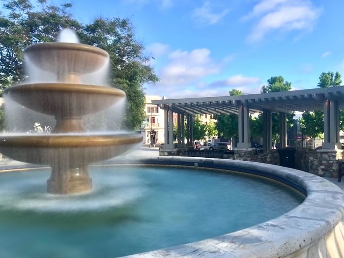 Town square fountain Public Fountain Pergola Springtime Long Exposure Long Exposure Shot Slow Shutter Fountain Sky Spraying Park - Man Made Space Reflection No People Park Flowing Water Motion Outdoors