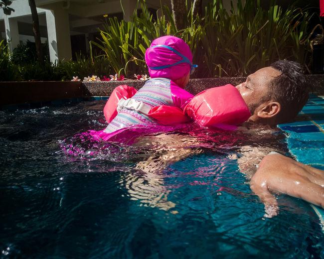 High angle view of girl and swimming pool