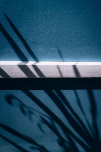 High angle view of shadow on railing