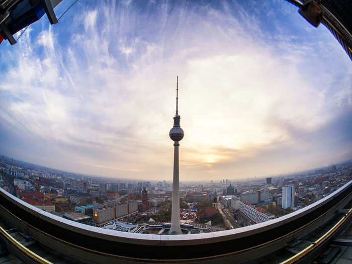 Architecture Berlin Building Exterior Built Structure City Cityscape Cloud - Sky Communication Day Fish-eye Lens Modern No People Outdoors Sky Skyscraper Sunset Tall - High Television Tower Tourism Tower Travel Destinations Urban Skyline