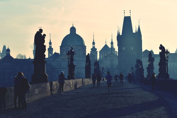 Classic Prague at dawn The Street Photographer - 2019 EyeEm Awards The Great Outdoors - 2019 EyeEm Awards The Architect - 2019 EyeEm Awards Beauty In Nature City Statue Place Of Worship Sculpture Fog Cityscape Ancient Religion History Silhouette Urban Skyline
