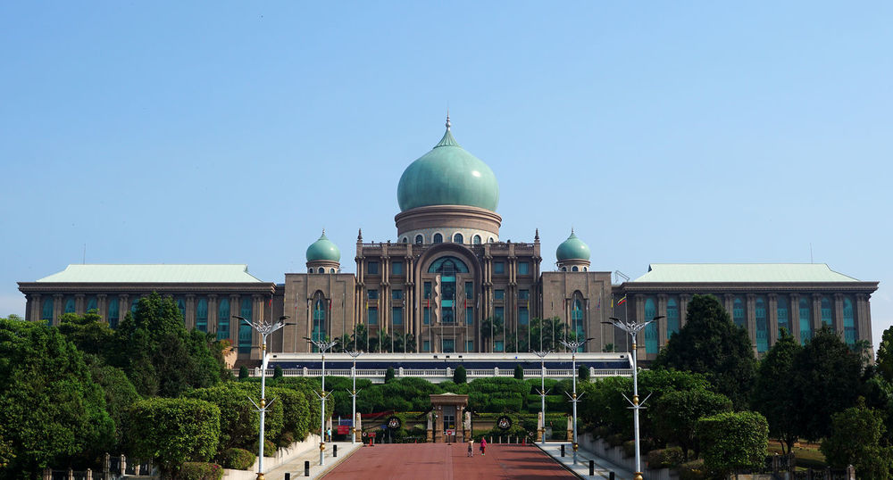 Malaysia Prime minister office with blue sky background Architecture Building Exterior Built Structure City Clear Sky Day Dome Government Malaysia No People Office Building Outdoors Place Of Worship Politics And Government Prime Minister Sky Travel Destinations Tree