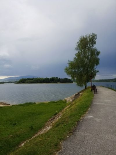 stormy weather Birch Pier Storm Coming Calm Before The Storm Shoreline Lake Lake View Tree Water Lake Water's Edge Beach Sky Grass Landscape Cloud - Sky Lakeshore Storm Cloud Tranquil Scene Thunderstorm Countryside Growing Cumulonimbus Idyllic