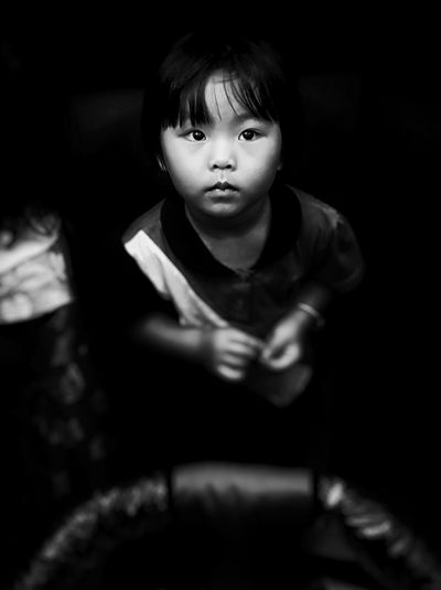 Black And White Friday One Person Sitting Child People Children Only Childhood Front View Indoors  Communication One Girl Only Technology Wireless Technology Adult Night Human Hand