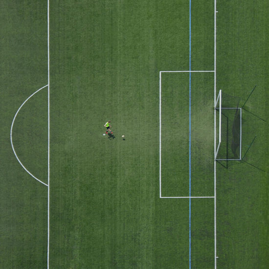 High Angle View Of Soccer Ball On Green Grass
