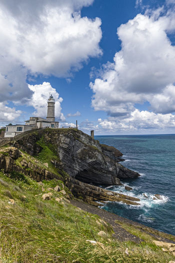Cabo Mayor lighthouse in Santander, Cantabria, Spain Aerial Architecture Atlantic Background Beach Beautiful Blue Building Cabo Cantabria Cape  City Cliff Coast Coastline Day Faro Green Landmark Landscape Light Lighthouse Maritime Mayor Mountain Nature Navigation Nobody North Ocean Outdoor Region Rock Santander Scenery Scenic Sea Shore Sky SPAIN Stone Sunset Symbol Tourism Travel View Viewpoint Water Wave White