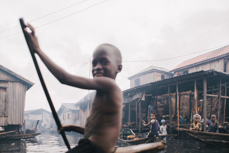 Boy-hood TheWeekOnEyeEM Streetphotography Water Men One Person Transportation Architecture Built Structure Nautical Vessel Lifestyles Males  Shirtless Leisure Activity Child Connection Childhood Boys Sky Bridge - Man Made Structure Outdoors Bridge Day My Best Travel Photo