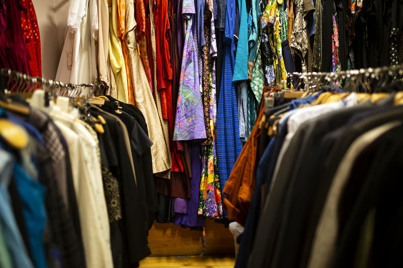 Clothes hanging in rack for sale at market