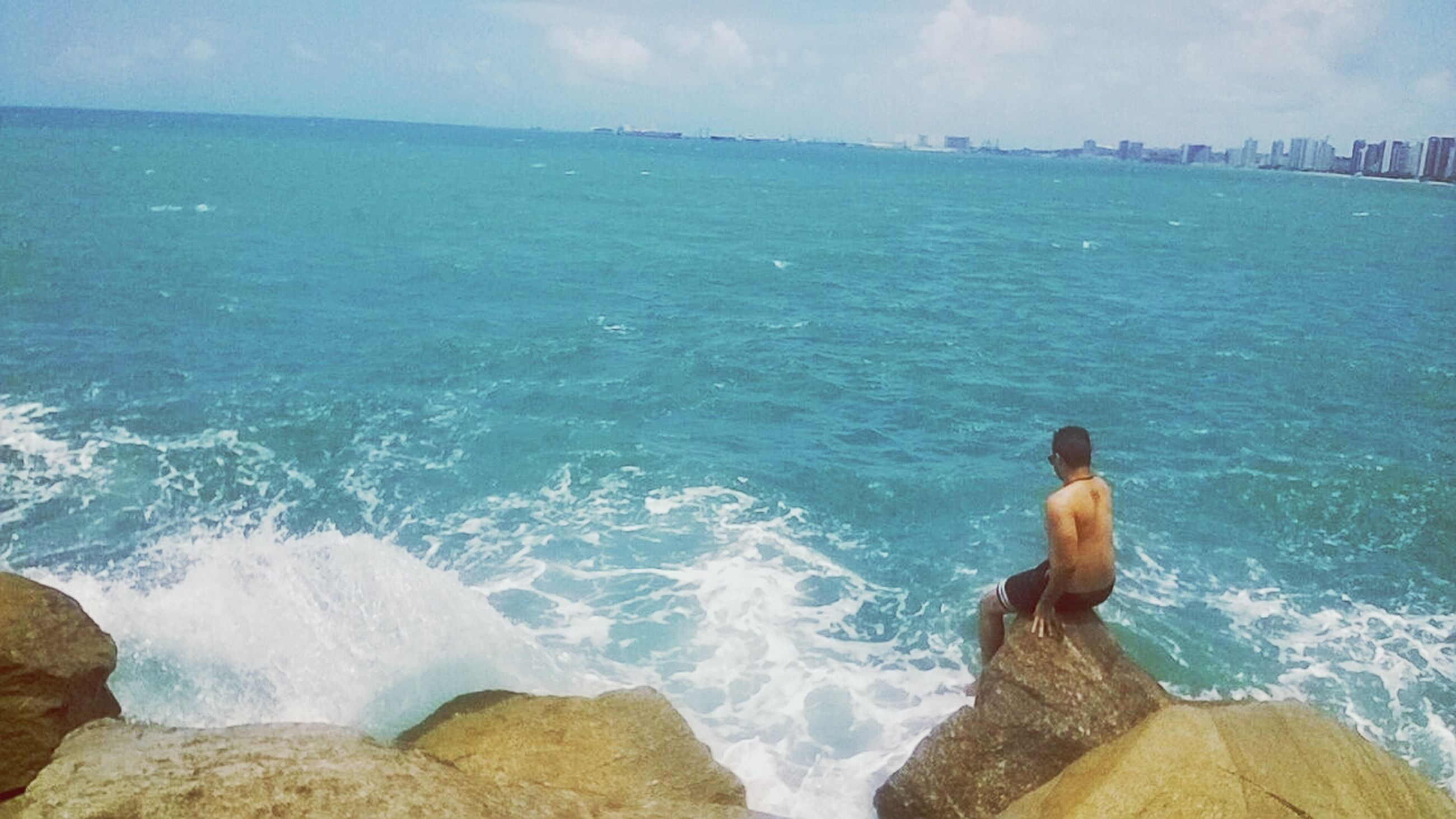 sea, water, rear view, real people, horizon over water, sky, beauty in nature, outdoors, day, wave, one person, beach, motion, leisure activity, men, scenics, nature, women, people, adult