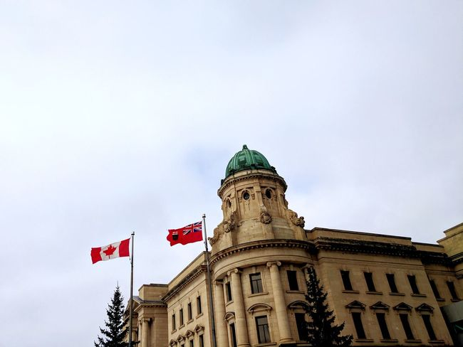 Flag Patriotism Government Architecture Sky City Politics And Government Dome Low Angle View Building Exterior Politics No People Day Outdoors Manitoba Manitoba Canada Manitoba Flag Canada Canada Flag