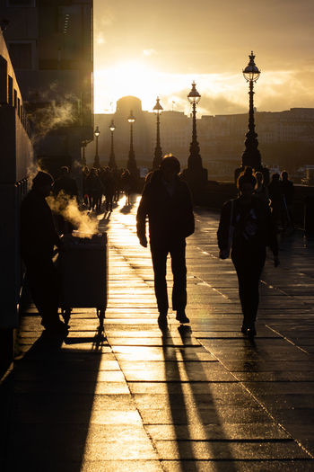 Where The Streets Are Paved With Gold Streetphotography LONDON❤ London Street Photo Street Photography Malephotographerofthemonth The Street Photographer - 2018 EyeEm Awards Capturestreets Streetlifeworldwide City Sunset Silhouette Full Length Sky Focus On Shadow Shadow Long Shadow - Shadow Pavement