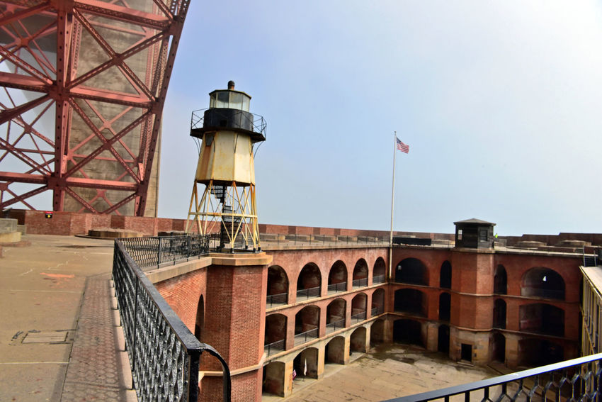 Fort Point Lighthouse 7 San Francisco CA🇺🇸 Fort Point Lighthouse Beneath South Anchorage Golden Gate Bridge Atop The Wall Fort Point Original Lighthouse Built 1853 2nd Built 1855 Current Lighthouse Built 1863 28ft. Tall Iron Skeletal Tower Circular Iron Staircase 5th Order Fresnel Lens Lighthouse _Collection Rooftop Penthouse Parapet Wall Barbette Tier Cannon Mounts Arches Barracks Casemates Penthouse Flag Fog