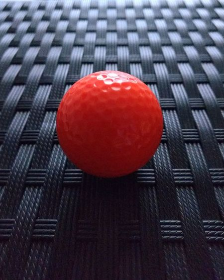 High angle view of red ball on table