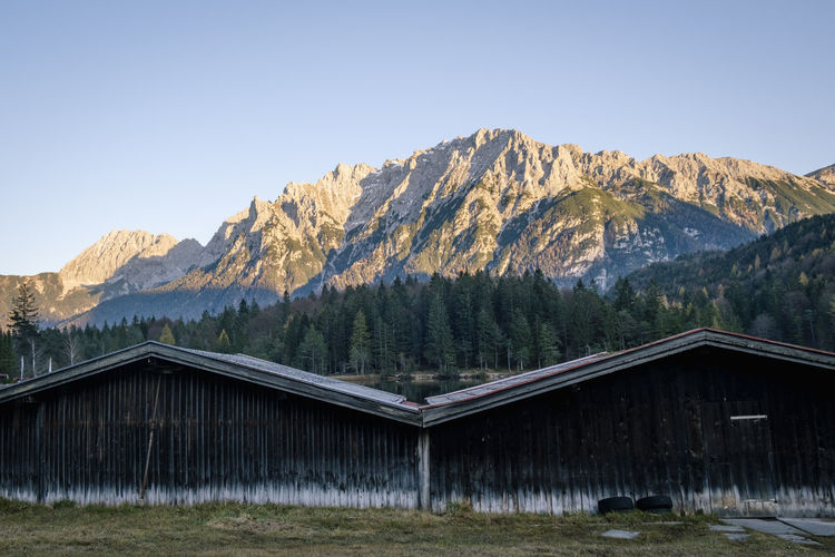 View of built structure against trees and mountains