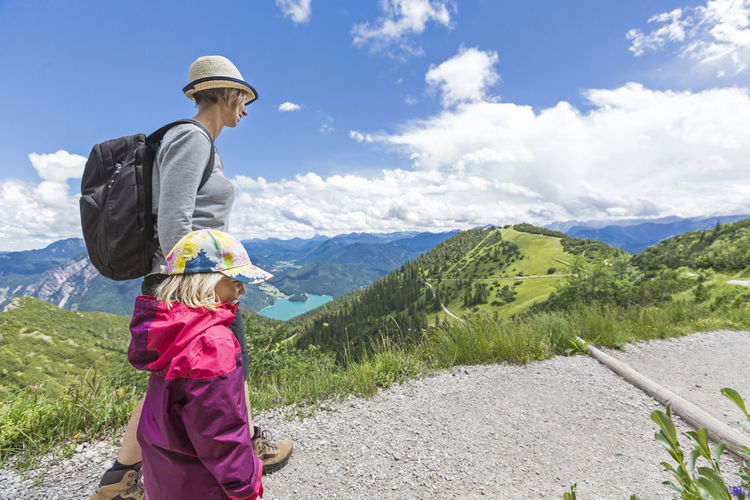 Mother and daughter on a hiking tour at the mountains Activity Adventure Alps Bayern Daughter Family Herzogstand Hiking Holiday Kochel Kochelsee Lake Mother Mountain Mountain Range Outdoors Panorama Recreation  Summer Südtirol Take A Walk Togetherness Unfiltered Walchensee Walking