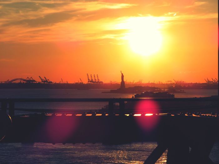 Statue of Liberty City New York Statue Of Liberty Sea Sunset Orange Color Beauty In Nature EyeEm Best Shots NYC NYC Photography Sea And Sky View Landscape Brooklyn Bridge / New York