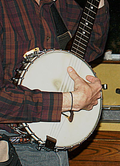 Hands of a man playing a banjo, in close-up. Adult Arts Culture And Entertainment Banjo Banjo Player Close-up Day Human Body Part Human Hand Indoors  Man's Hand Music Music Musical Instrument Musician One Man Only One Person Only Men Playing Plucking An Instrument Real People Strumming
