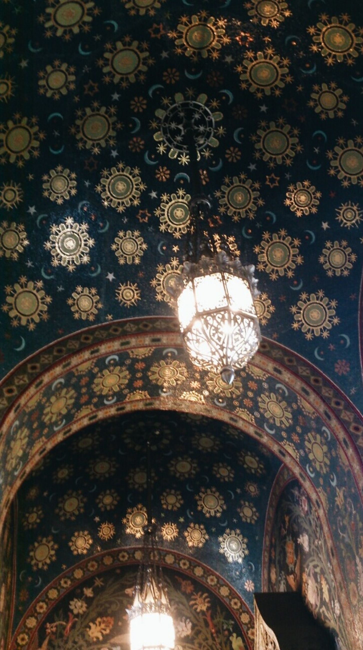 low angle view, indoors, architecture, built structure, ceiling, arch, illuminated, pattern, ornate, design, lighting equipment, religion, place of worship, no people, architectural feature, spirituality, history, decoration, sunlight
