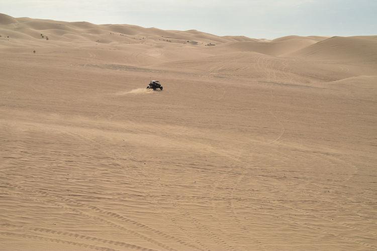 Vehicle moving on desert
