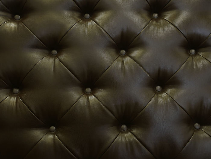 Luxury leather decoration in Brown tones or background. Pattern Backgrounds Furniture Full Frame No People Sofa Textile Indoors  Close-up Button Textured  Retro Styled Leather Design Abstract Decoration Brown Old Shape Luxury Softness Leather Daybed Wallpaper Interior Design