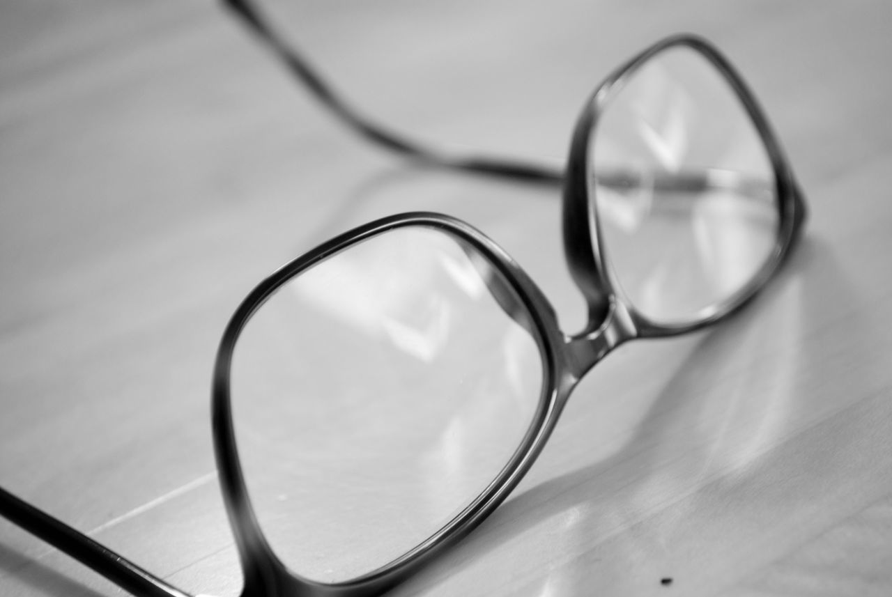 glasses, glass - material, eyeglasses, close-up, still life, transparent, indoors, eyesight, table, no people, focus on foreground, selective focus, personal accessory, eyewear, scrutiny, magnifying glass, vision, shadow, single object, day